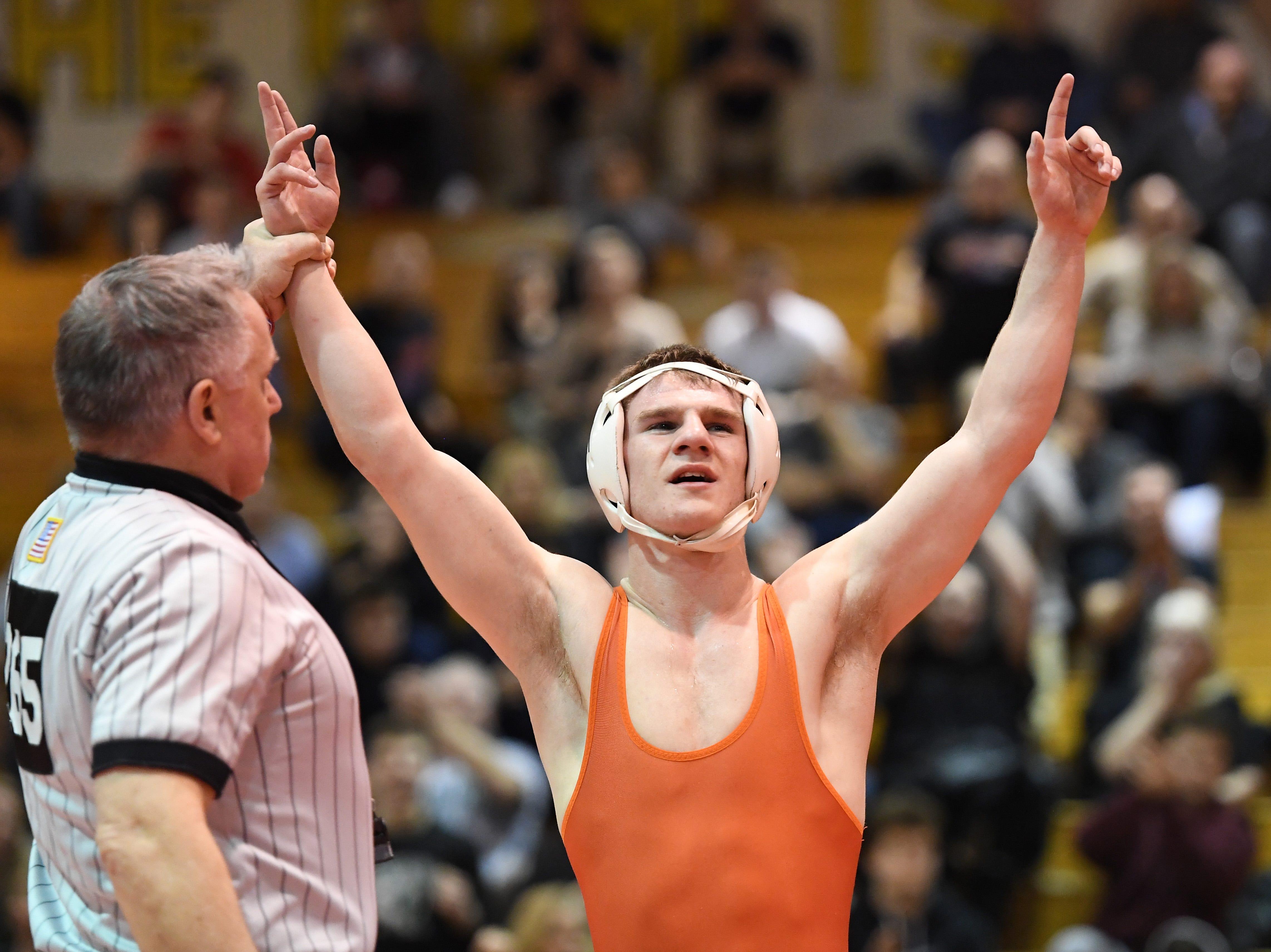 Bergen County wrestling finals at Hackensack High School on Friday, December 28, 2018. Gianni Manginelli (Dumont)  celebrates winning his 126 pound match.