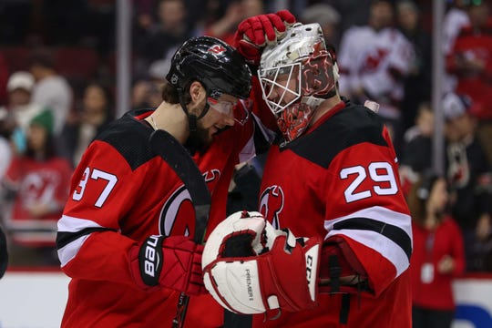 Dec 29, 2018; Newark, NJ, USA; New Jersey Devils center Pavel Zacha (37) and New Jersey Devils goaltender Mackenzie Blackwood (29) celebrate the Devils 2-0 win over the Hurricanes at Prudential Center. Blackwood recorded his first career NHL shutout.