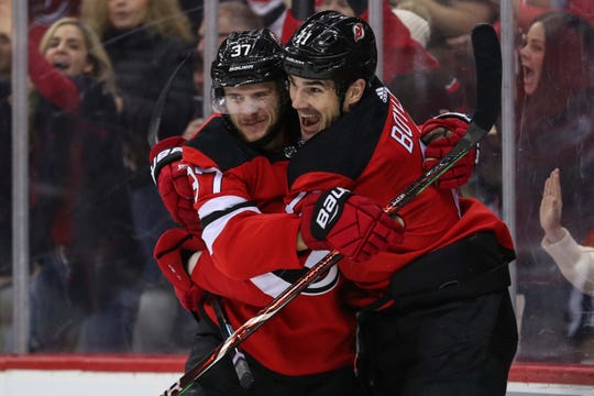 Dec 29, 2018; Newark, NJ, USA; New Jersey Devils center Pavel Zacha (37) celebrates his goal with New Jersey Devils center Brian Boyle (11) during the second period of their game against the Carolina Hurricanes at Prudential Center.
