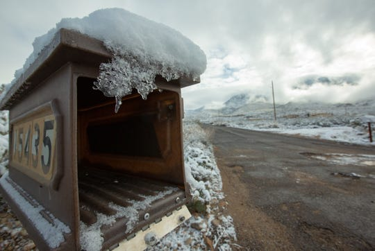A mailbox is covered with ice and snow just off Baylor Canyon Road on Saturday Dec. 29, 2019.