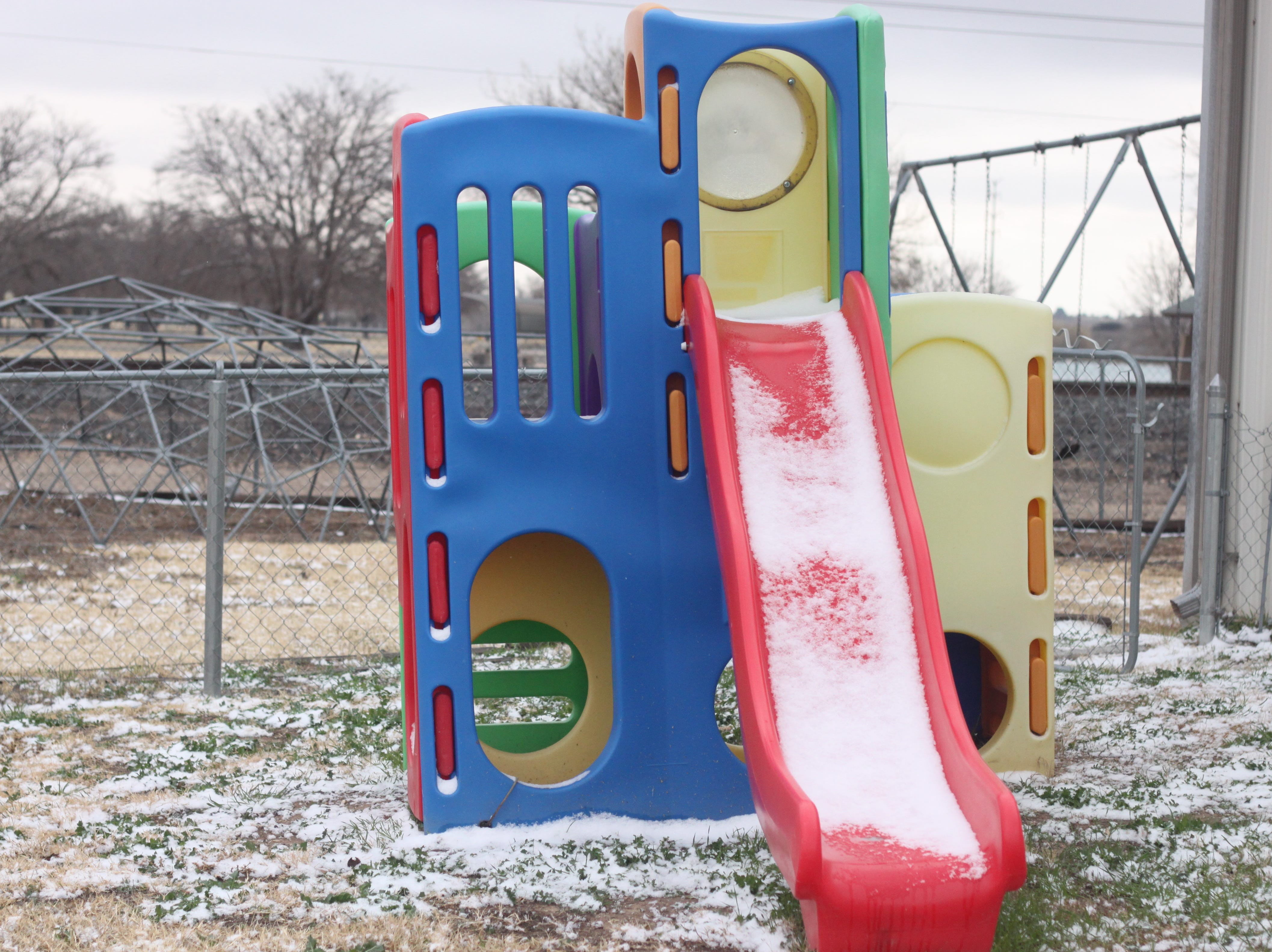 A playground is covered in snow, Dec. 29, 2018 in Carlsbad.