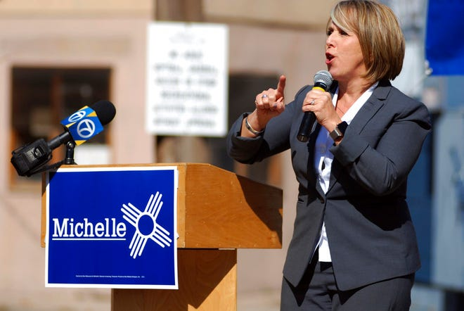 In this Oct. 25, 2018 photo, New Mexico gubernatorial candidate and U.S. Rep. Michelle Lujan Grisham speaks to an audience including many unionized state workers in Santa Fe.