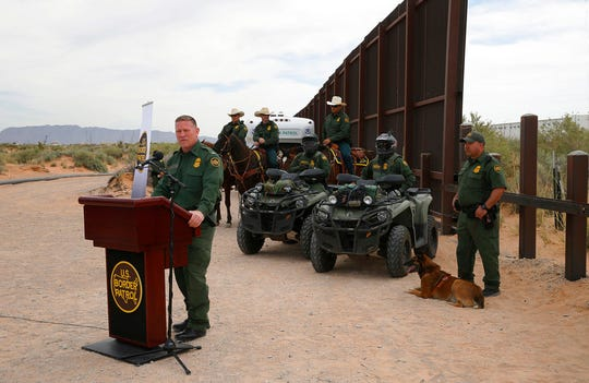 In this April 9, 2018, file photo, Aaron Hull, chief patrol agent of the U. S. Customs and Border Protection's El Paso Sector, speaks where construction on a new segment of the border wall will be built, near Santa Teresa.