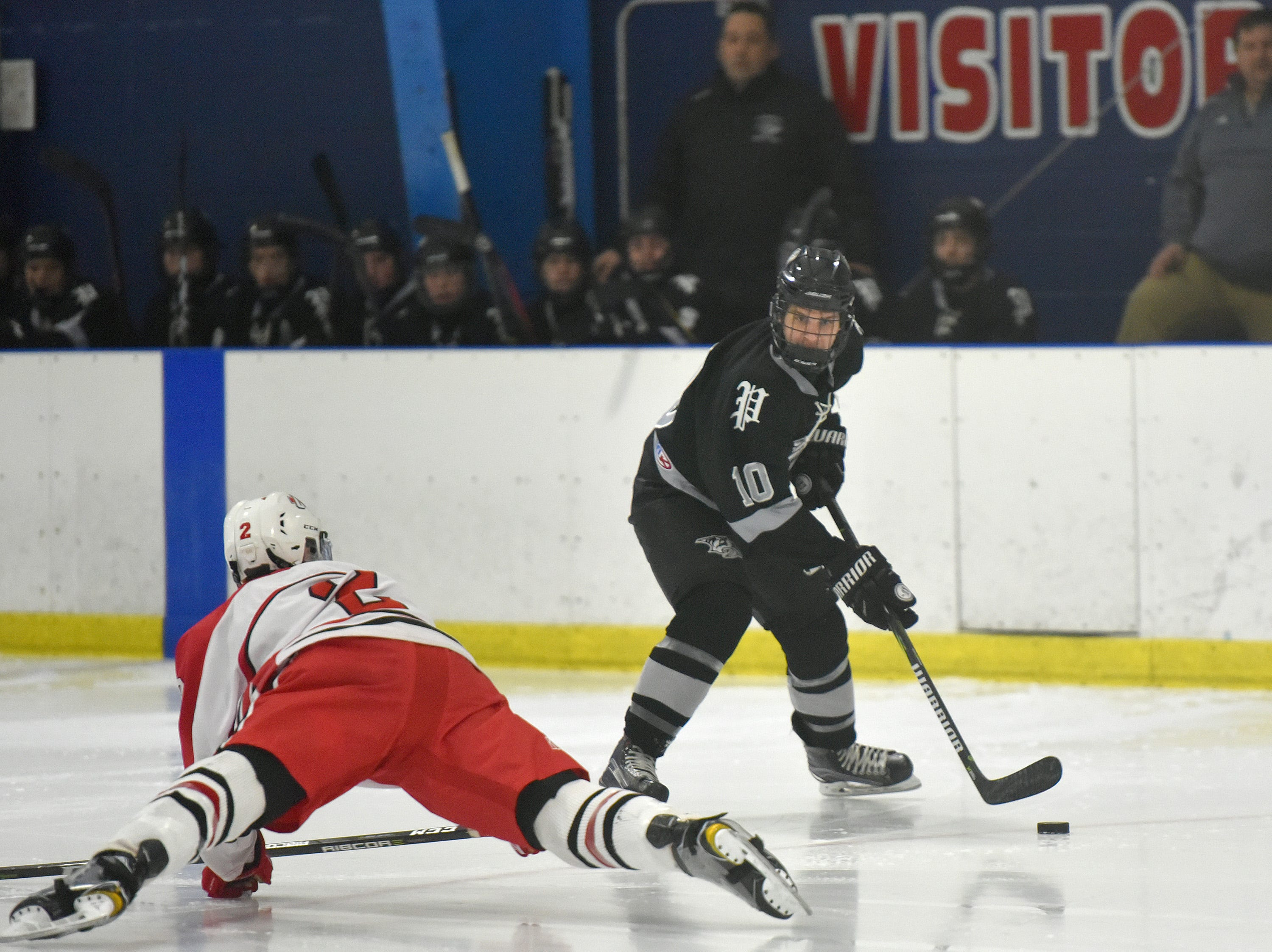 Wildcat forward Jeff Koviak (10) skates past Chief Tyler Laski (2).