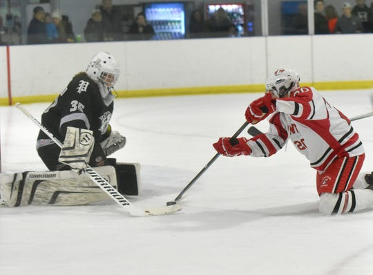 Canton Chief Chris Hugan (20) makes a shot on goal, but Wildcat goalie Joel Drucker (35) makes the save.