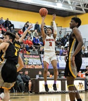 Canton senior guard B. Artis White (3) led the Chiefs in scoring with 15 points in a 50-45 win Dec. 28 at North Farmington.