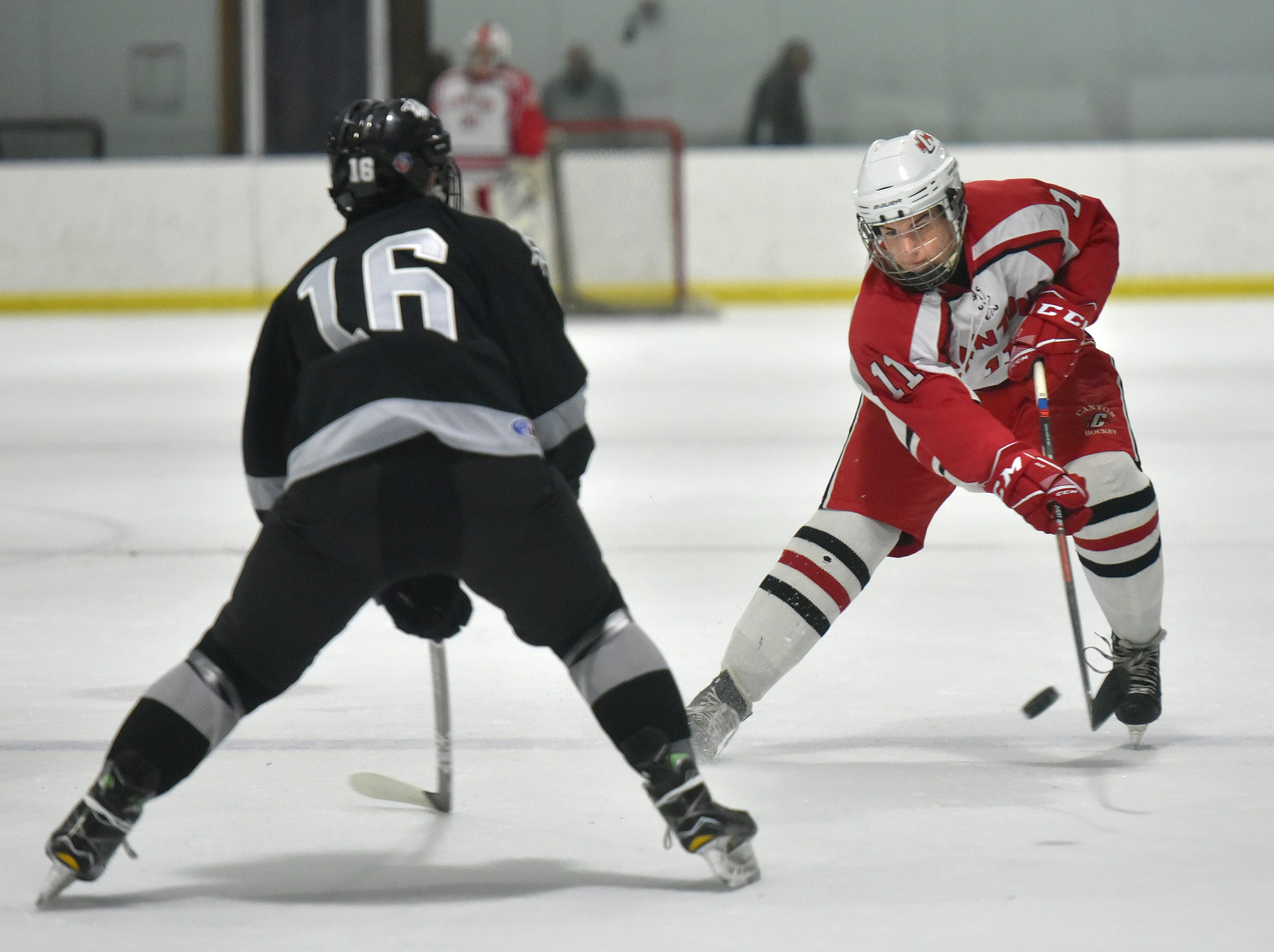 Chief Lenny Kubitski (11) tries to work the puck past Wildcat defender Kyle Ahern (16).