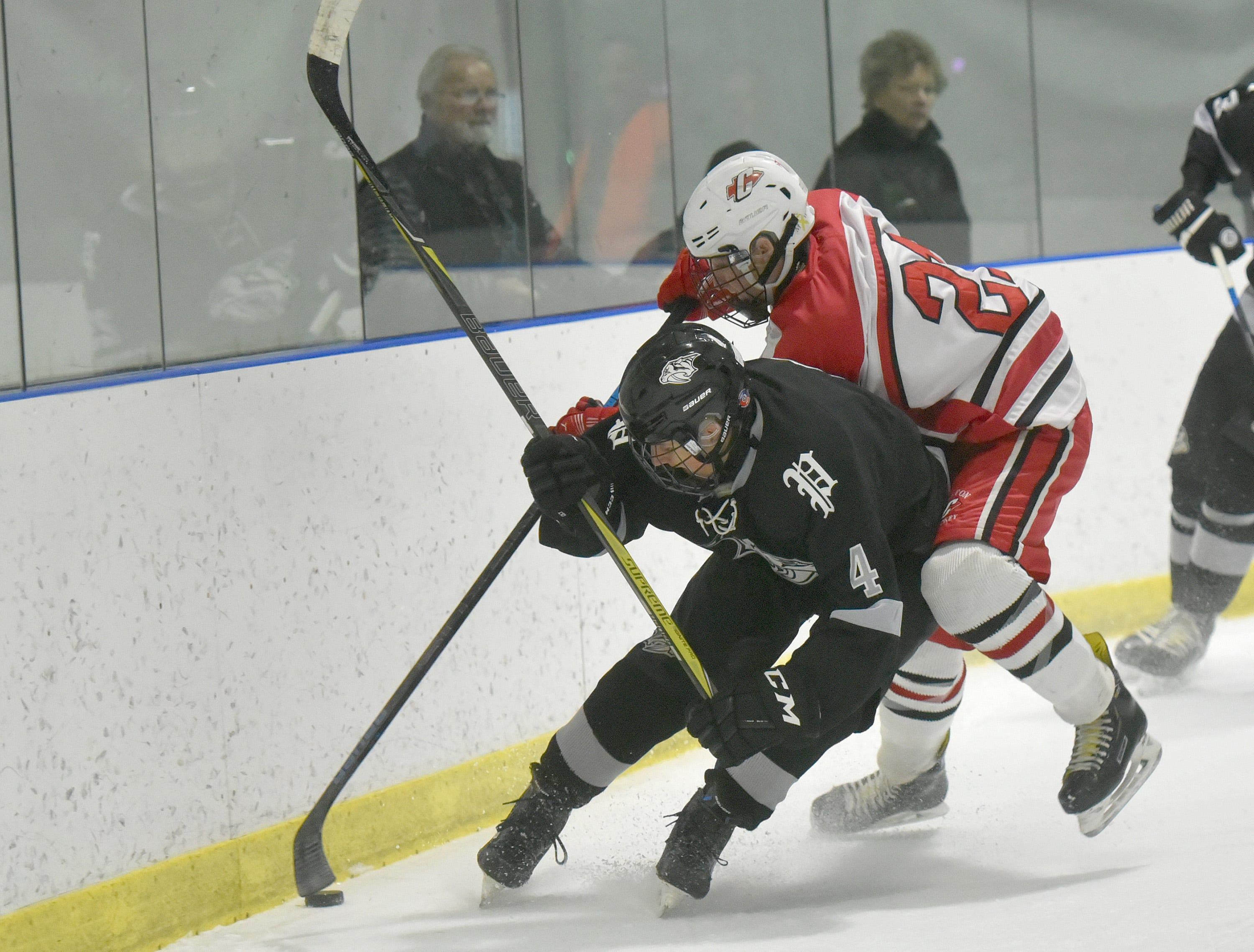 Wildcat Brendan Matey (4) and Chief Sammy McArdle mix it up behind the Canton net.