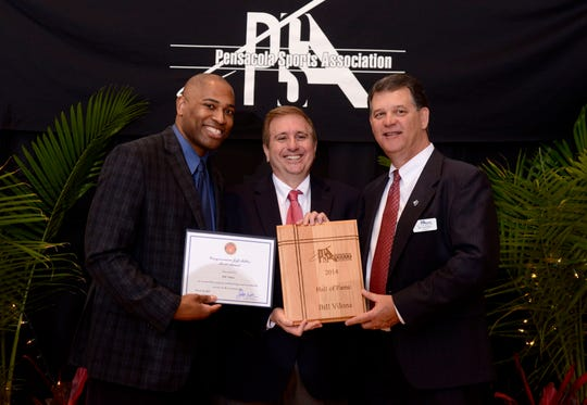 Bill Vilona, center, veteran sports reporter for the Pensacola News Journal, joined by then-Pensacola Sports president Bill Hamilton, left, and former Alabama and NFL running back Shaun Alexander, after being inducted in 2014 into the Pensacola Sports Hall of Fame.