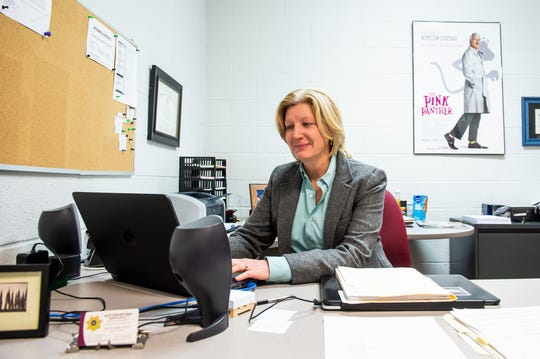 Detective Sergeant Lisa Layden works in her office at the Southwestern Regional Police Department in York County on Wednesday, December 26, 2018. Almost 20 years ago, Layden was the first female police officer to work in her department, and within her first year of working, she noticed a difference in how people responded to her compared to her male coworkers.
