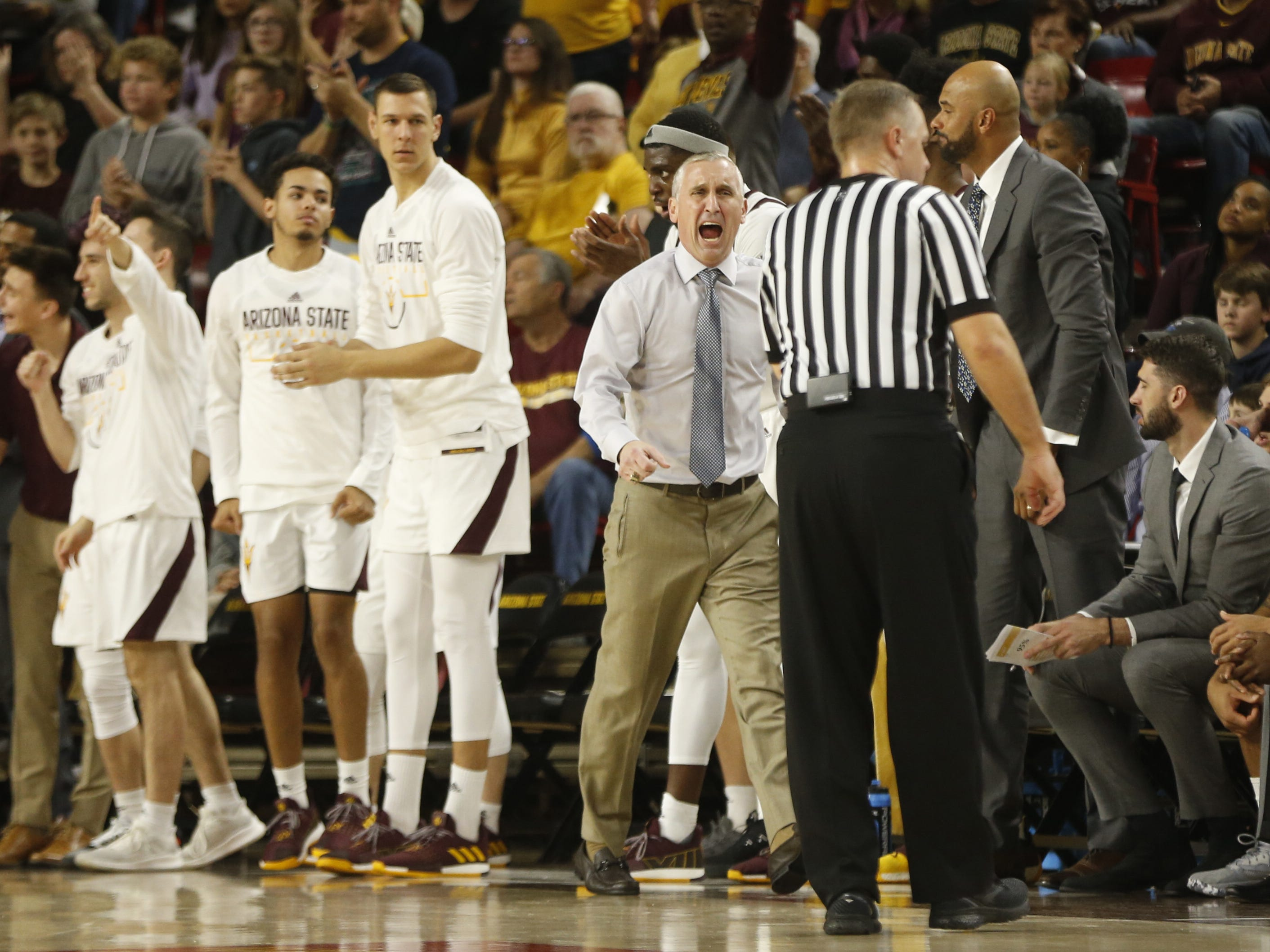 ASU's head coach Bobby Hurley yells at an official arguing a call during the first half against Princeton at Wells Fargo Arena in Tempe, Ariz. on December 29, 2018.