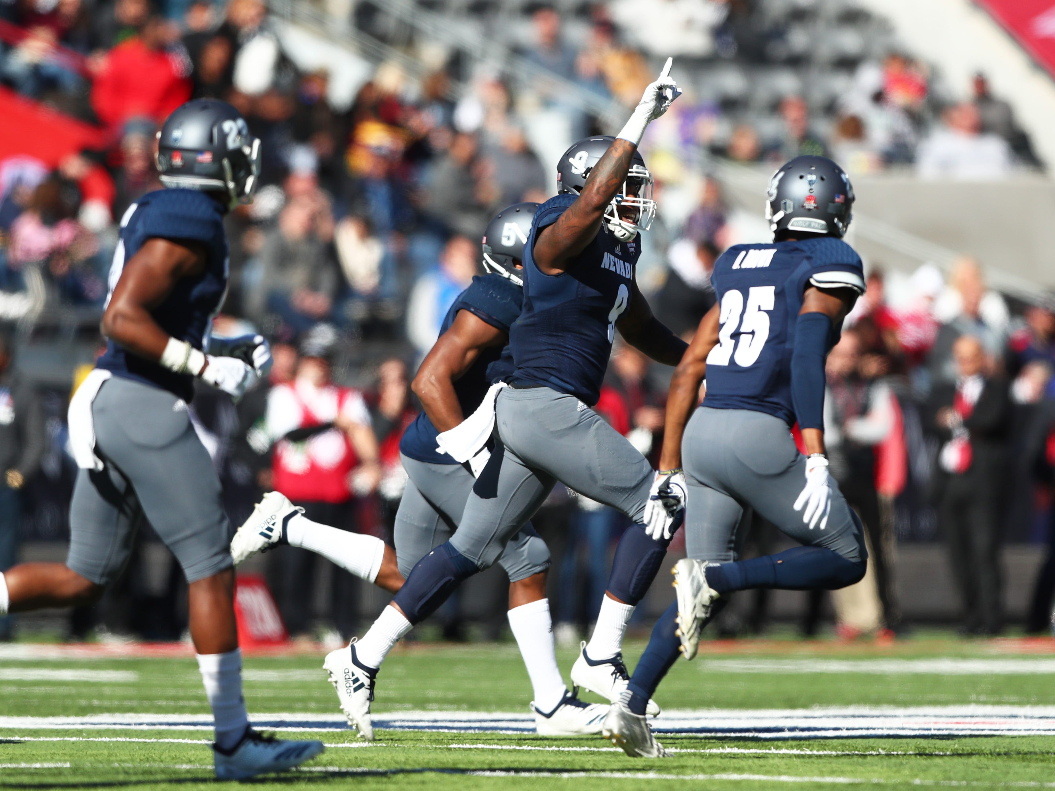 Dec 29, 2018; Tucson, AZ, USA; Nevada Wolf Pack defensive back Justin Brent (center) celebrates an interception in the first half against the Arkansas State Red Wolves in the 2018 Arizona Bowl at Arizona Stadium.