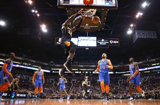 Phoenix Suns center Deandre Ayton slam-dunks the ball against the Oklahoma City Thunder on Dec. 28 at Talking Stick Resort Arena in Phoenix.