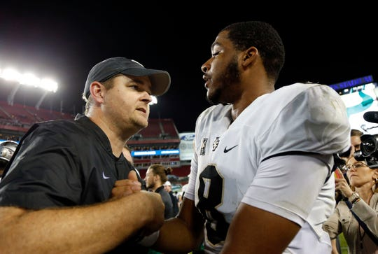 UCF Knights head coach Josh Heupel, quarterback Darriel Mack Jr. (8) talk and hug as they beat the South Florida Bulls at Raymond James Stadium Nov. 23, 2018. Kim Klement-USA TODAY Sports