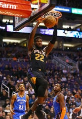 Phoenix Suns center Deandre Ayton slam-dunks the ball against the Oklahoma City Thunder on Dec. 28 at Talking Stick Resort Arena in Phoenix.