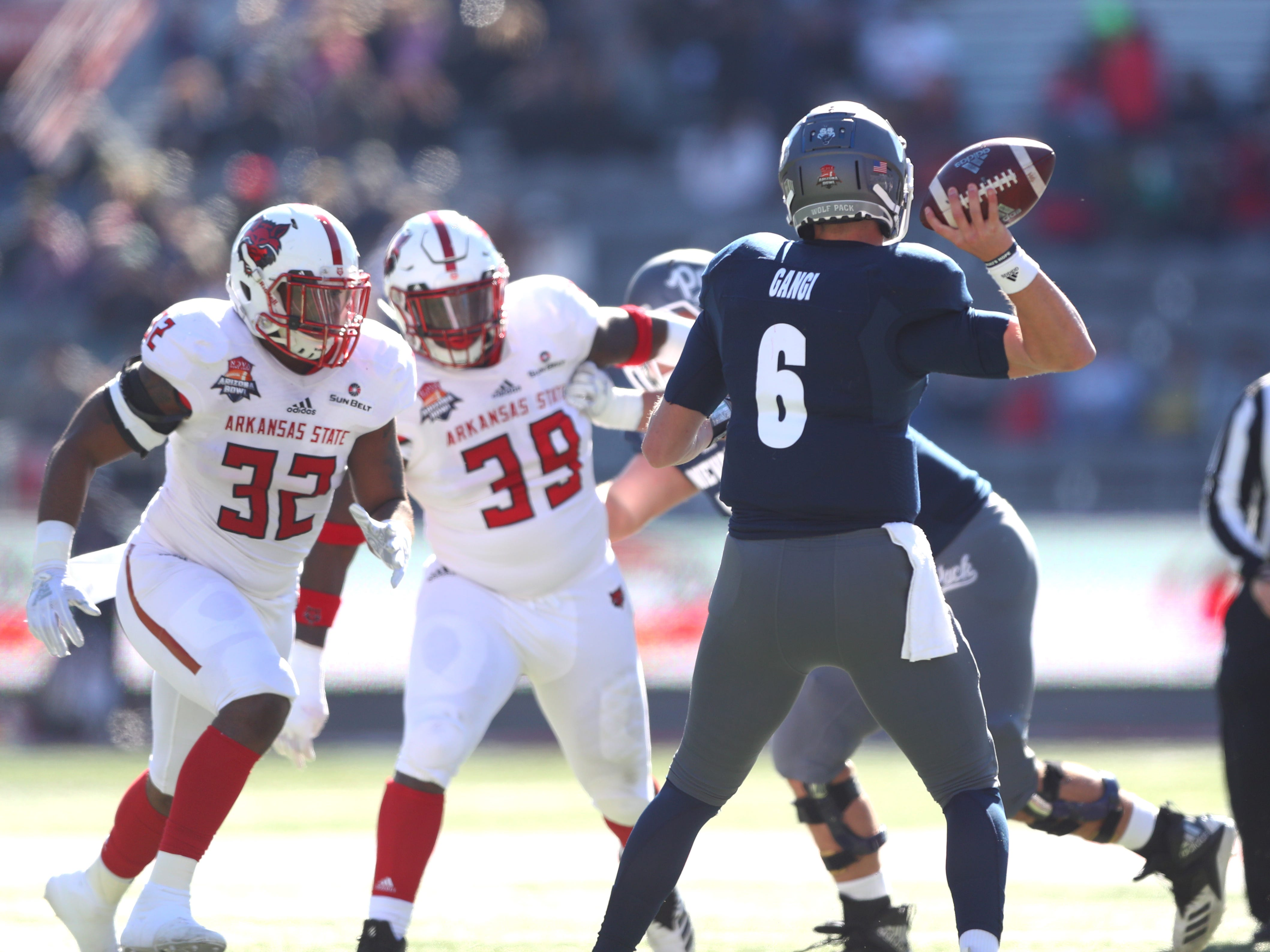 Dec 29, 2018; Tucson, AZ, USA; Nevada Wolf Pack quarterback Ty Gangi (6) against the Arkansas State Red Wolves in the first half of the 2018 Arizona Bowl at Arizona Stadium.