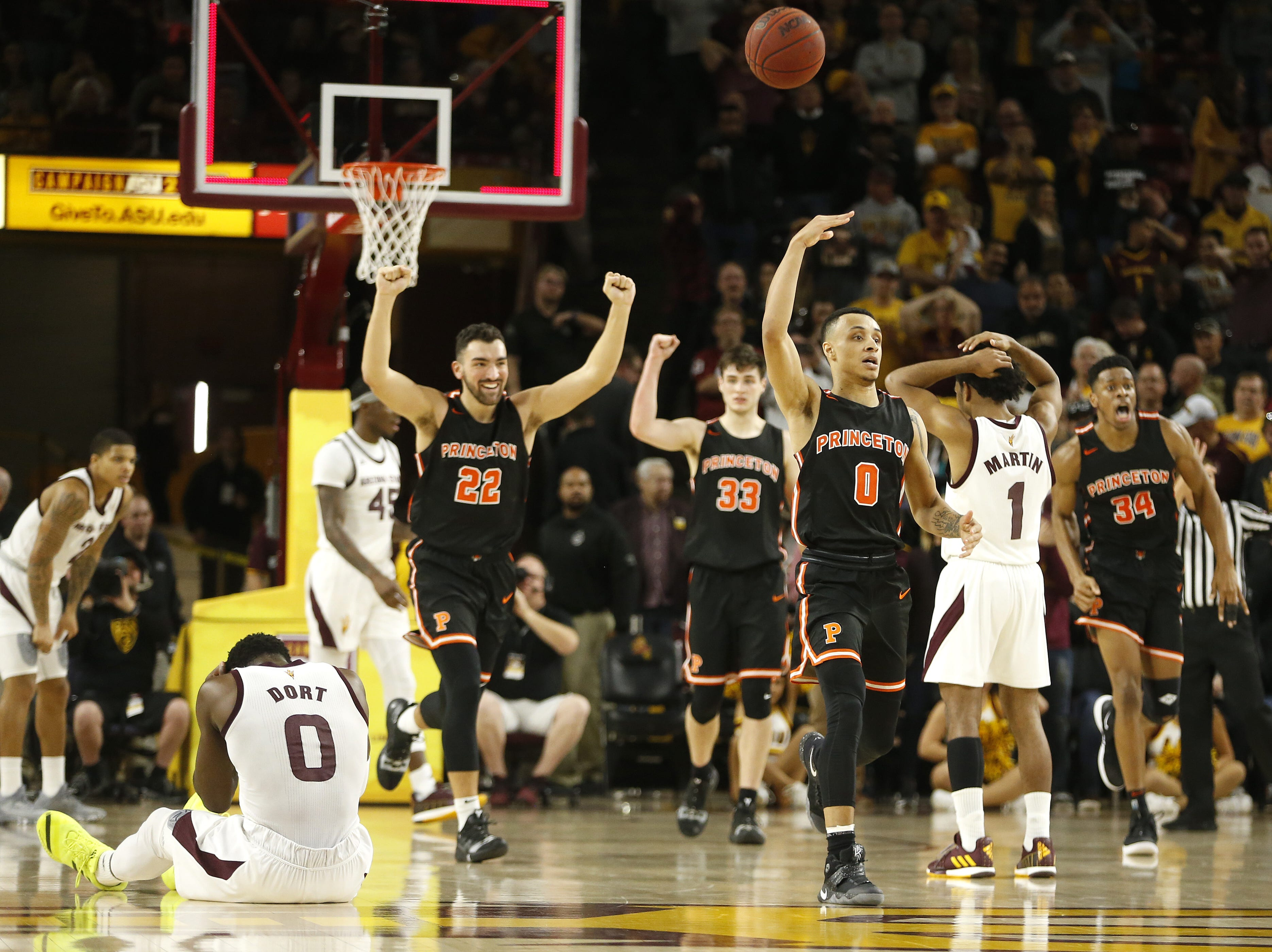 Princeton's Jaelin Llewellyn (0) tosses the ball in celebration after ASU's Luguentz Dort (0) missed a potential game-winning shot sealing the 67-66 Princeton win at Wells Fargo Arena in Tempe, Ariz. on December 29, 2018.