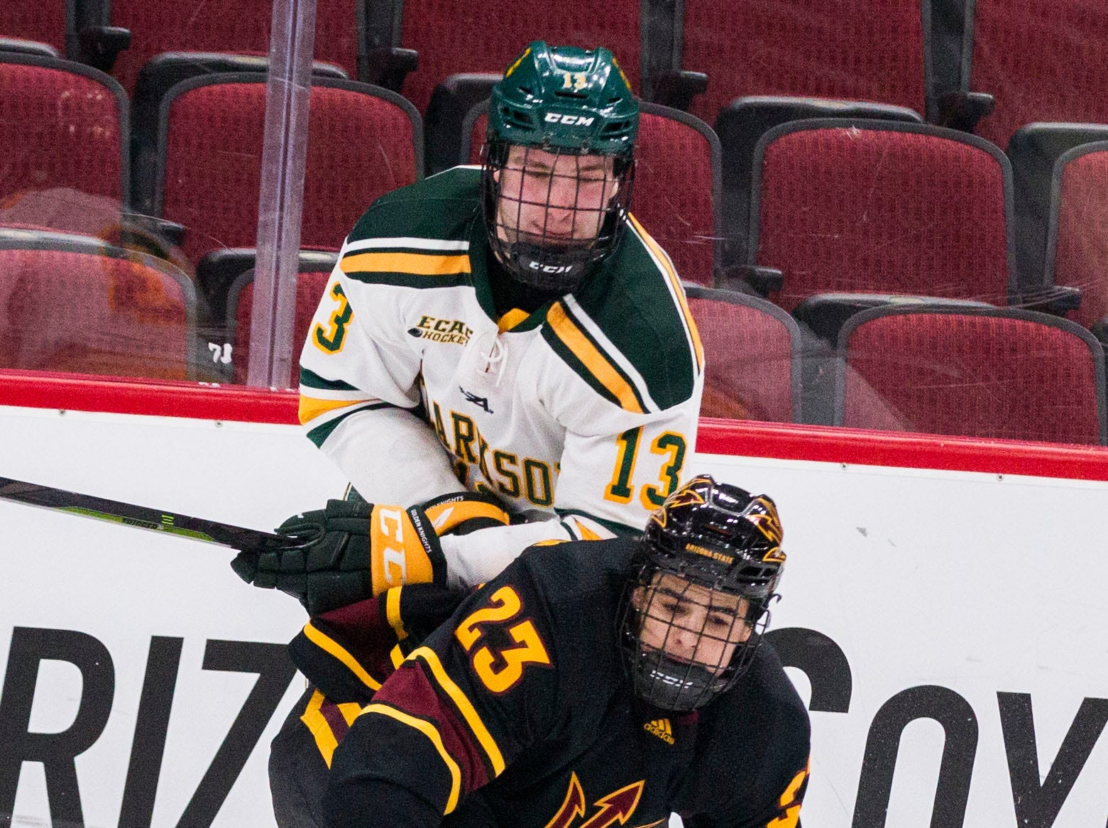Arizona State University's Demetrios Koumontzis (23) loses the puck against Clarkson's Aaron Thow(13) during the second period of their game in the 2018 Desert Hockey Classic in Glendale, Friday, Dec. 28, 2018.