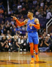 Oklahoma City Thunder guard Russell Westbrook reacts after making his 40th point of the game against the Phoenix Suns on Dec. 28 at Talking Stick Resort Arena in Phoenix.