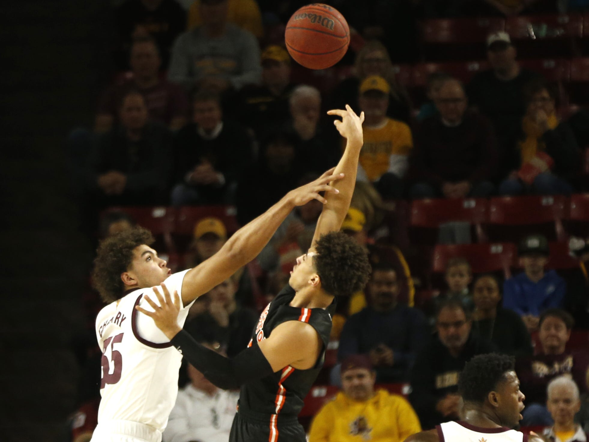 ASU's Taeshon Cherry (35) attempts to block Princeton's Devin Cannady (3) during the first half at Wells Fargo Arena in Tempe, Ariz. on December 29, 2018.