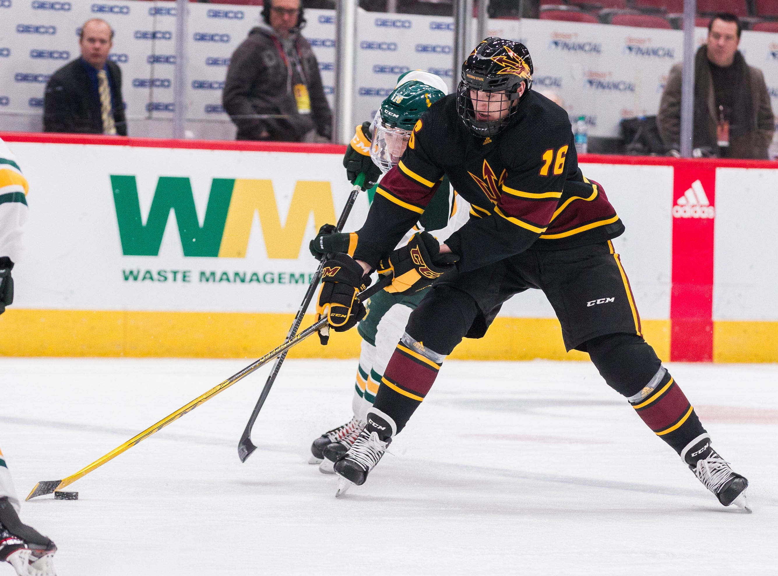 Arizona State University's Max Balinson (26) controls the puck against Clarkson's Jack Jacome (16) during the second period of their game in the 2018 Desert Hockey Classic in Glendale, Friday, Dec. 28, 2018.