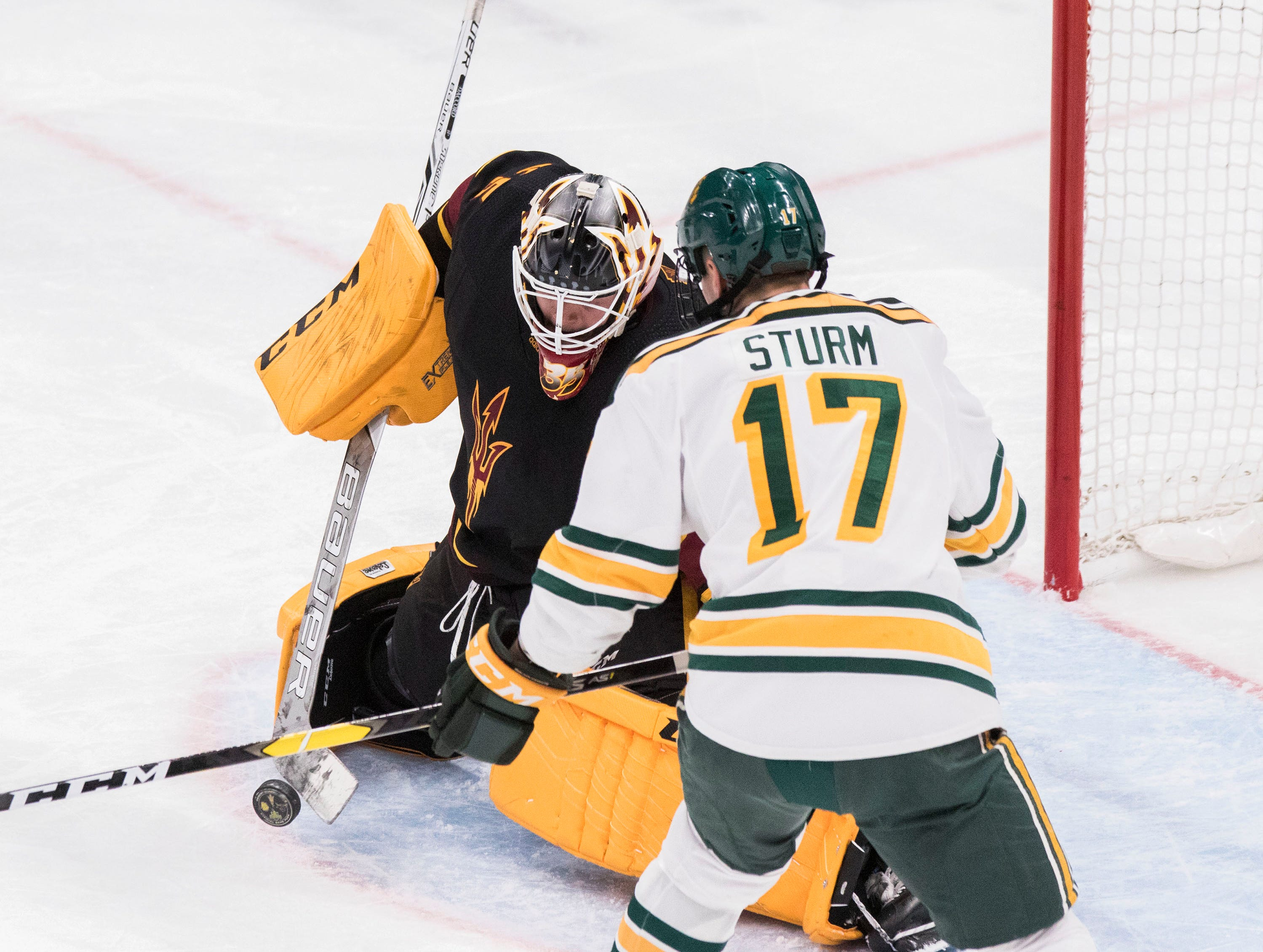 Arizona State University goalie Joey Daccord (35) saves the puck against Clarkson's Nico Sturm (17) during the first period of their game in the 2018 Desert Hockey Classic in Glendale, Friday, Dec. 28, 2018.