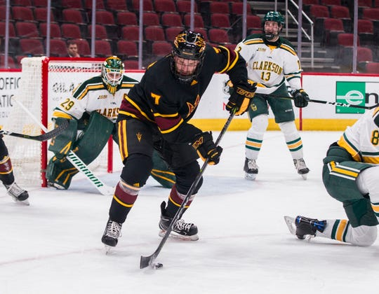 Arizona State University's Johnny Walker (7) controls the puck while trying to set up a power play against Clarkson's defense during the second period of their game in the 2018 Desert Hockey Classic in Glendale, Friday, Dec. 28, 2018.