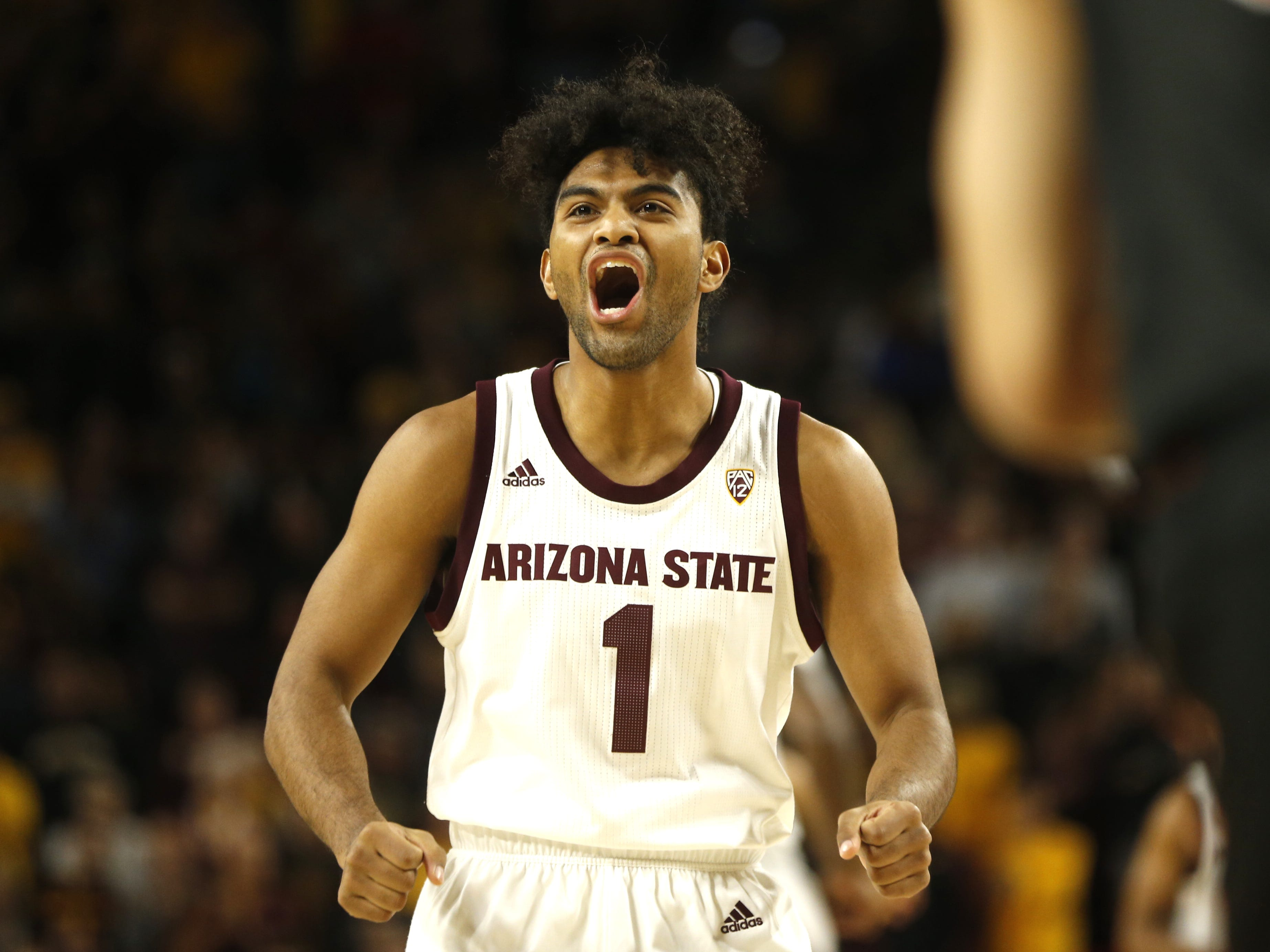 ASU's Remy Martin (1) screams after making the opening basket against Princeton during the first half at Wells Fargo Arena in Tempe, Ariz. on December 29, 2018.