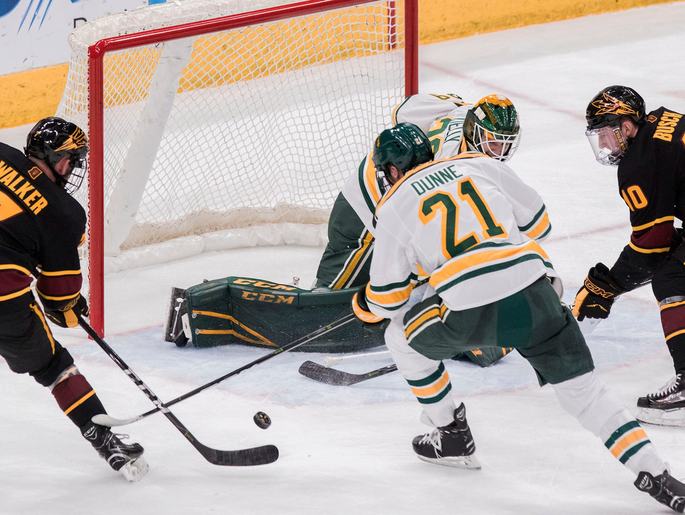 Arizona State University's Johnny Walker (7) just misses getting a shot off Clarkson's goalie Jake Kielly (28) during the first period of their game in the 2018 Desert Hockey Classic in Glendale, Friday, Dec. 28, 2018.