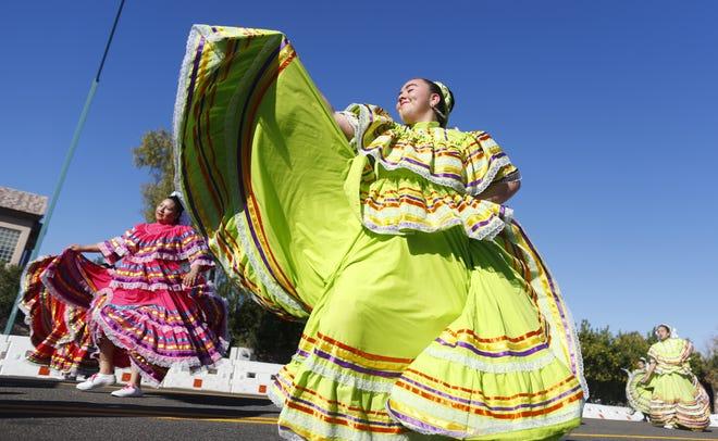 Ballet Folkorico Fuego de Phoenix performs during the Fiesta Bowl Parade in Phoenix on Dec. 29, 2018.