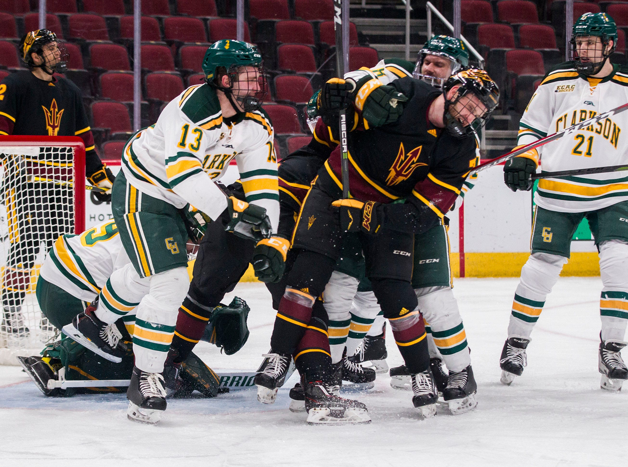 Arizona State University's Johnny Walker (7) is out numbered around the Clarkson goal during the second period of their game in the 2018 Desert Hockey Classic in Glendale, Friday, Dec. 28, 2018.