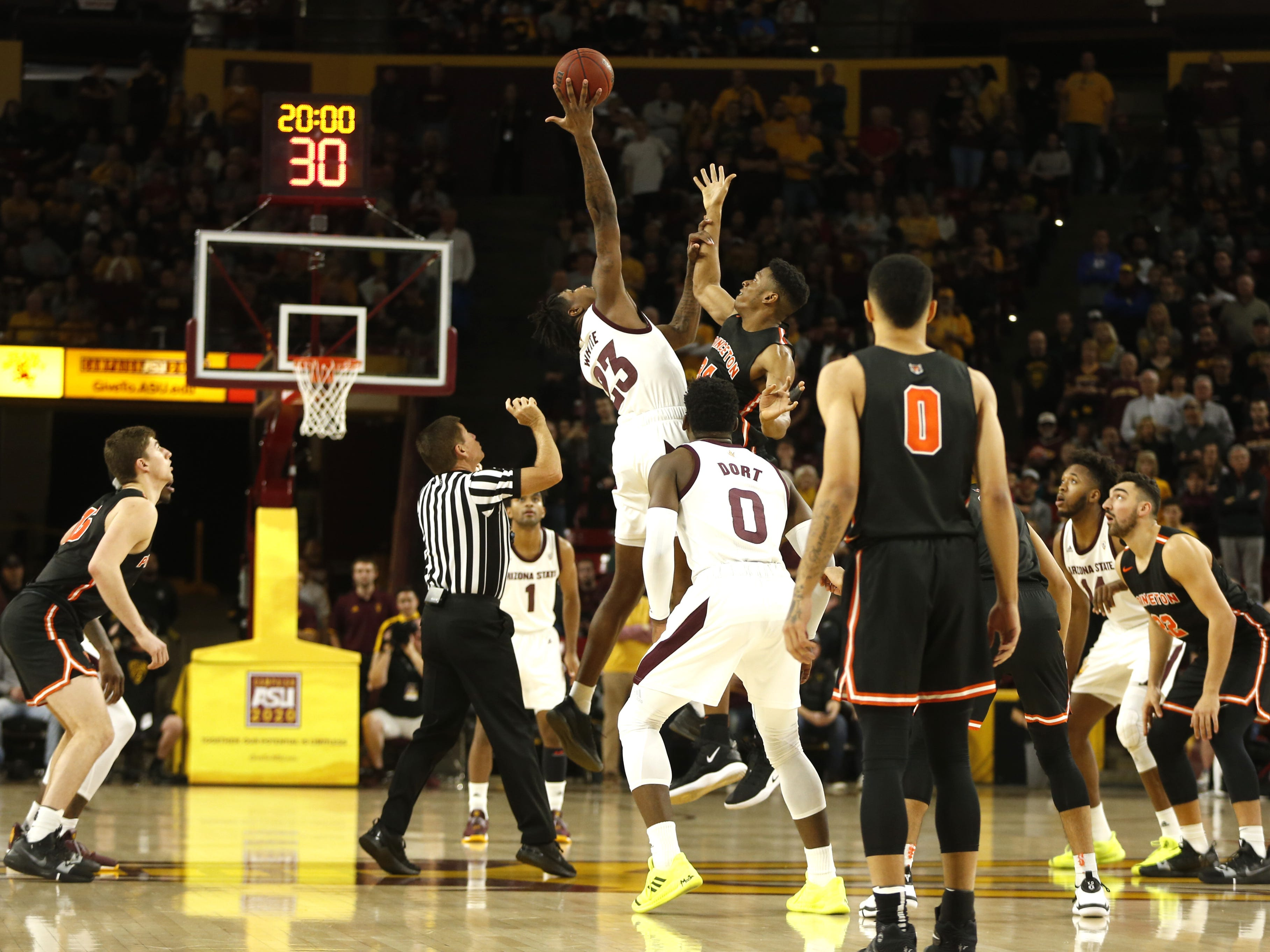 ASU's Romeo White (23) wins the tip-off against Princeton's Richmond Aririguzoh (34) during the first half at Wells Fargo Arena in Tempe, Ariz. on December 29, 2018.