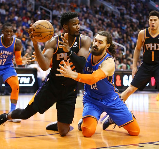 Phoenix Suns center Deandre Ayton steals the ball from Oklahoma City Thunder center Steven Adams on Dec. 28 at Talking Stick Resort Arena in Phoenix.