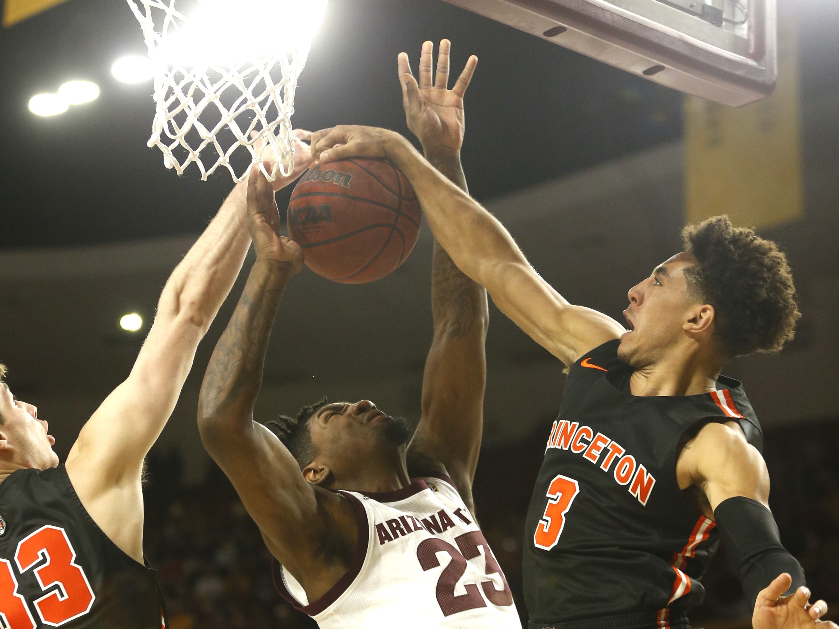 Princeton's Devin Cannady (3) blocks a shot on ASU's Romello White (23) during the first half at Wells Fargo Arena in Tempe, Ariz. on December 29, 2018.