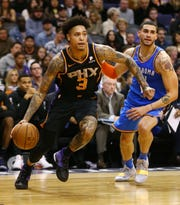 Phoenix Suns forward Kelly Oubre Jr. makes a move to the basket against the Oklahoma City Thunder on Dec. 28 at Talking Stick Resort Arena in Phoenix.