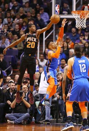 Phoenix Suns forward Josh Jackson blocks the shot from Oklahoma City Thunder guard Russell Westbrook on Dec. 28 at Talking Stick Resort Arena in Phoenix.