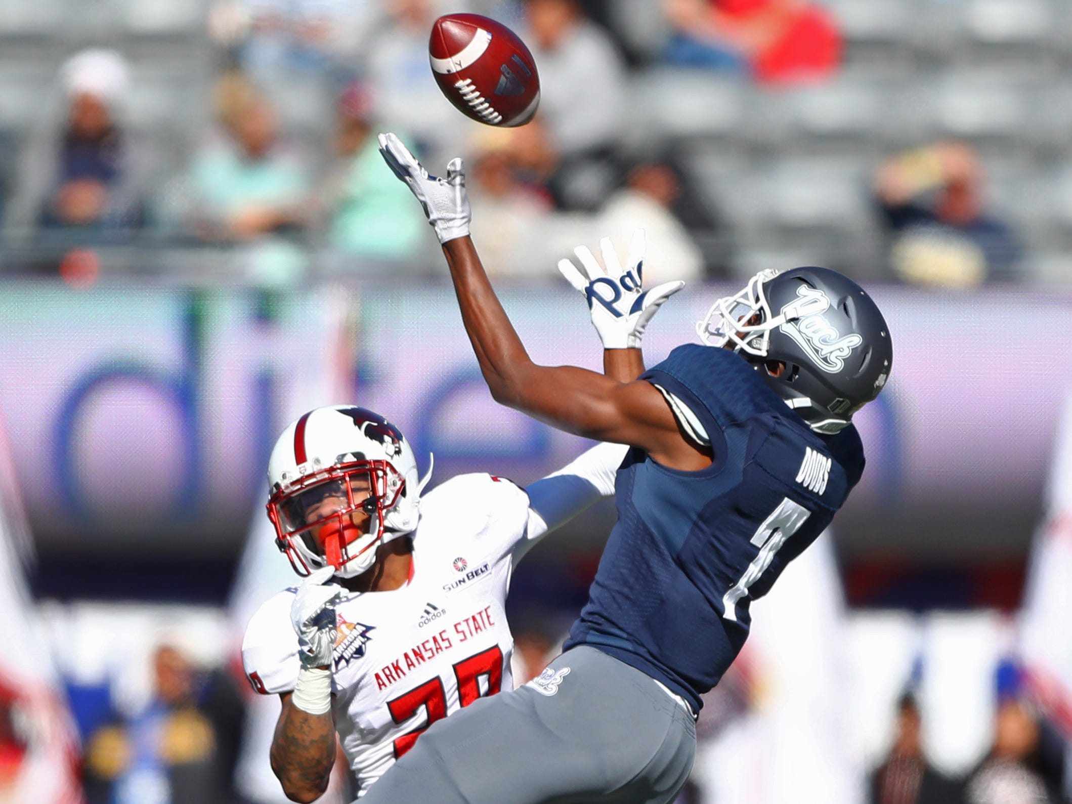 Dec 29, 2018; Tucson, AZ, USA; Arkansas State Red Wolves defensive back Brandon Byner (28) breaks up a pass intended for Nevada Wolf Pack wide receiver Romeo Doubs (7) in the first half of the 2018 Arizona Bowl at Arizona Stadium.