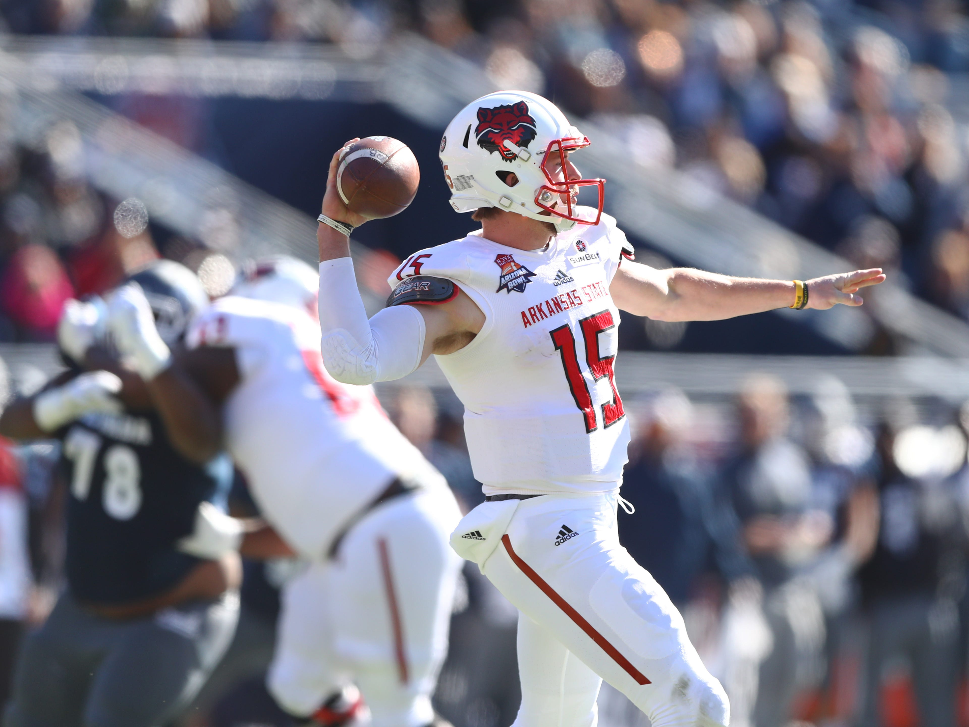 Dec 29, 2018; Tucson, AZ, USA; Arkansas State Red Wolves quarterback Justice Hansen (15) throws a pass against the Nevada Wolf Pack in the first half of the 2018 Arizona Bowl at Arizona Stadium.