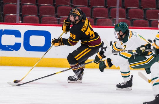 Arizona State University's Brinson Pasichnuk (39) controls the puck against Clarkson's Jordan Schneider (12) during the second period of their game in the 2018 Desert Hockey Classic in Glendale, Friday, Dec. 28, 2018.