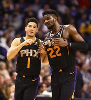 Phoenix Suns Devin Booker talks to Deandre Ayton against the Oklahoma City Thunder on Dec. 28 at Talking Stick Resort Arena in Phoenix.