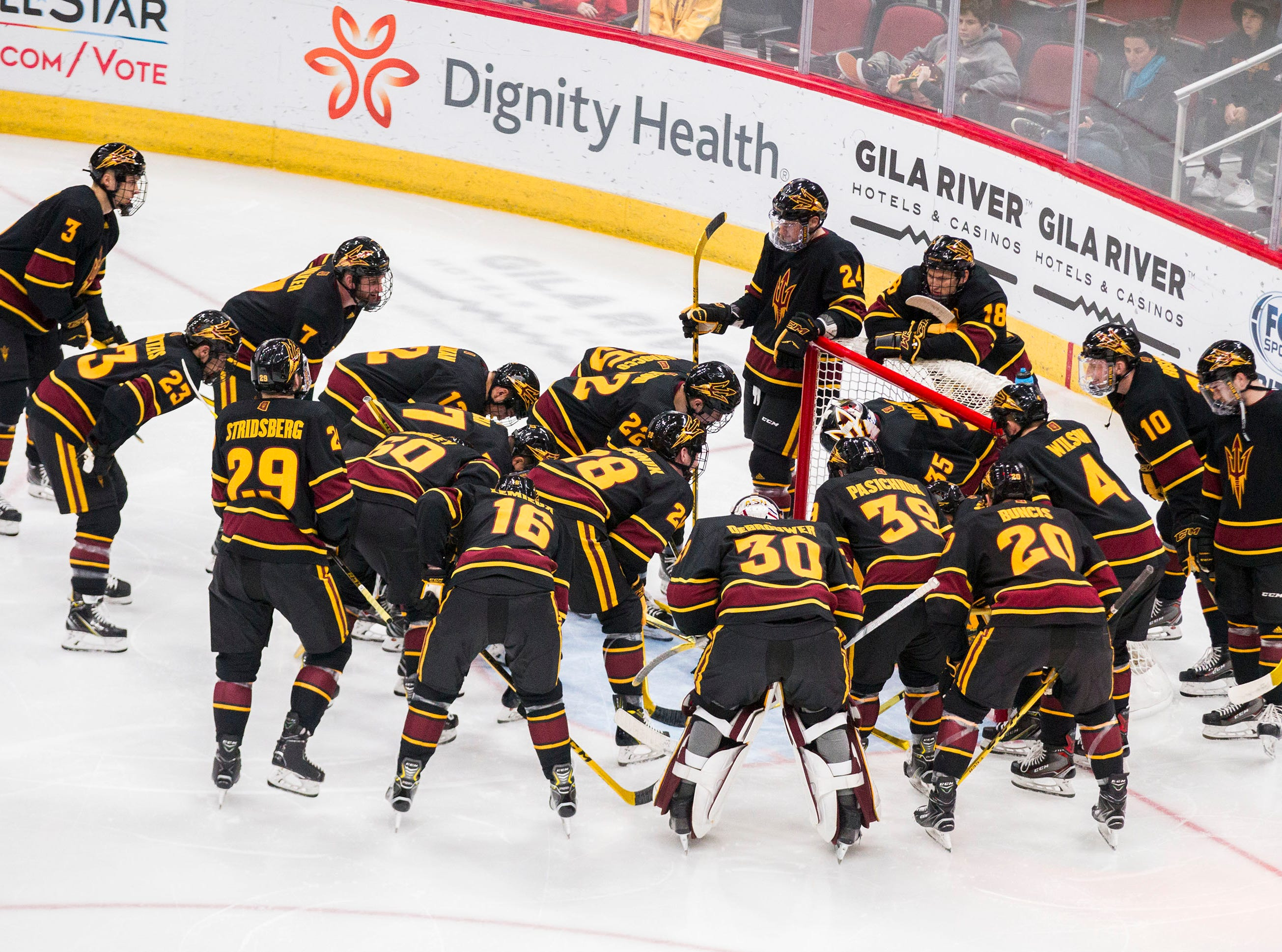 Arizona State University players huddle around the goal before their match against Clarkson in the 2018 Desert Hockey Classic in Glendale, Friday, Dec. 28, 2018.