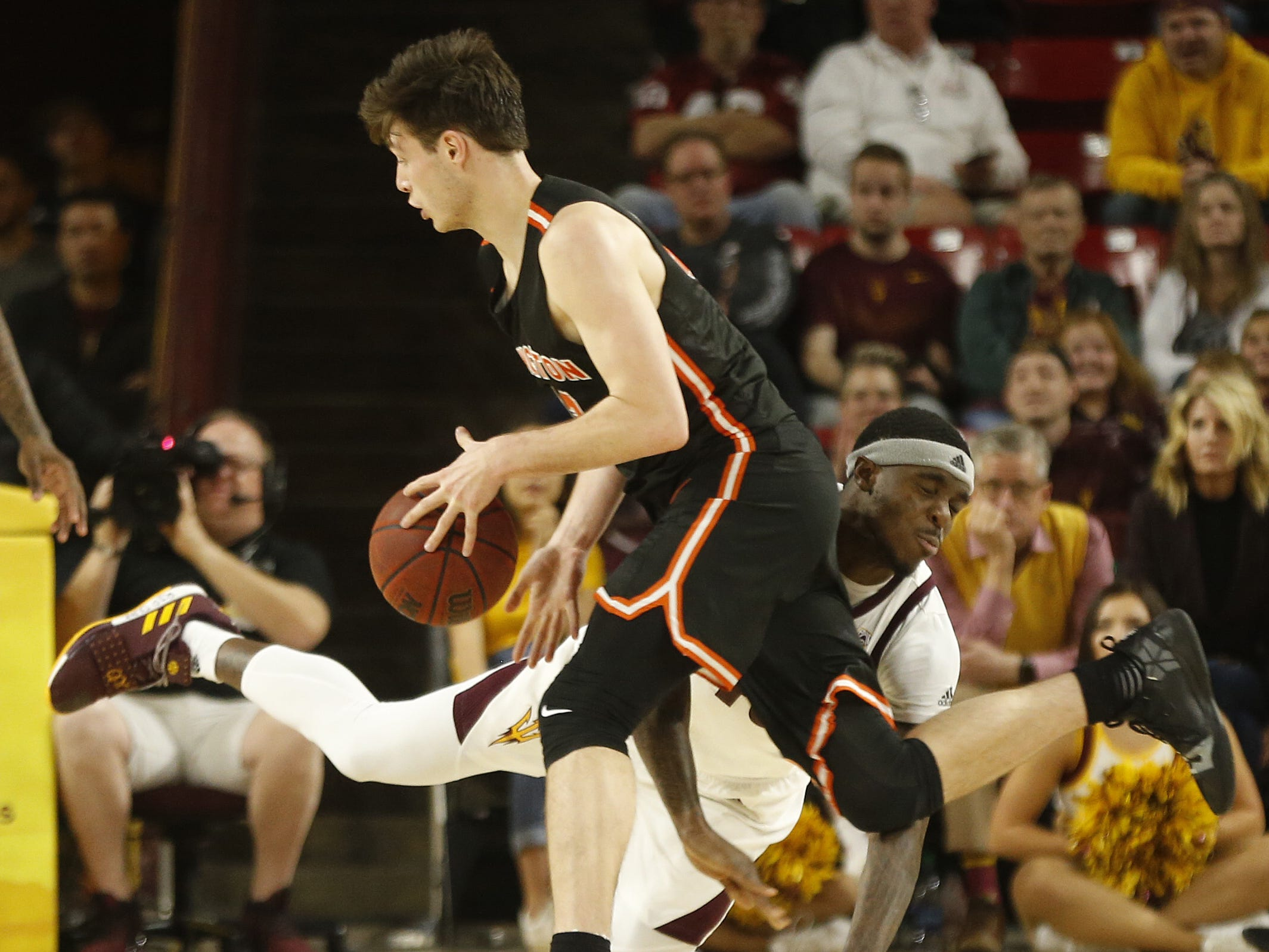 Princeton's Sebastian Much (33) draws a foul on ASU's Zylan Cheatham (45) during the first half at Wells Fargo Arena in Tempe, Ariz. on December 29, 2018.