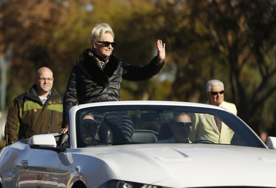 Cindy McCain waves to people during the Fiesta Bowl Parade in Phoenix on Dec. 29, 2018.