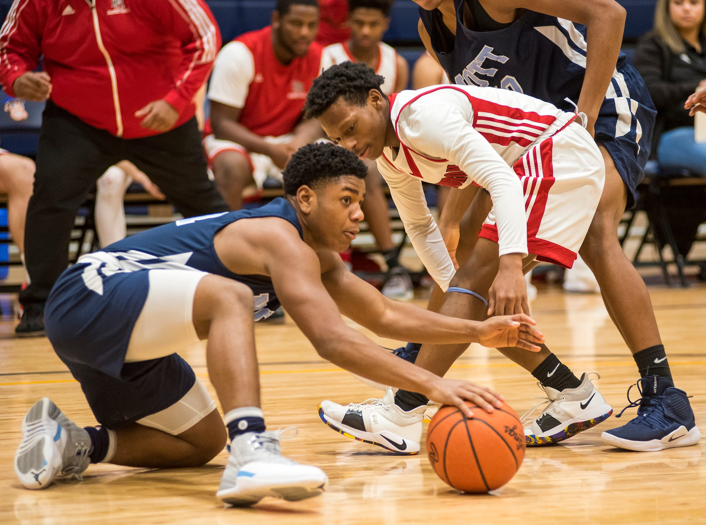 Port Huron High School guard Treshaun Lee (right) and Waterford Mott High School guard Keimonee Fields both reach for a loose ball during their SC4 Holiday Basketball Showcase game Saturday, Dec. 29, 2018 at the SC4 Fieldhouse.