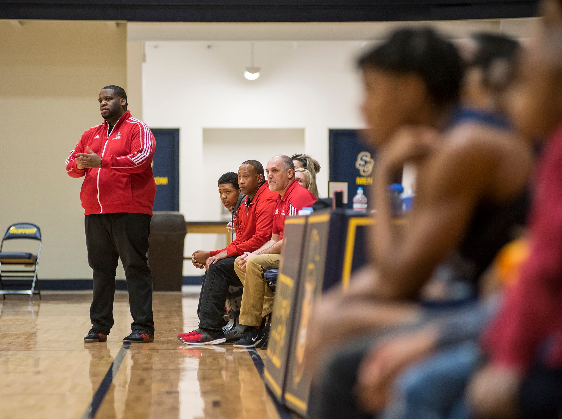 Port Huron High School head coach marion Stewart watches the  SC4 Holiday Basketball Showcase game against Waterford Mott High School from the sidelines Saturday, Dec. 29, 2018 at the SC4 Fieldhouse.