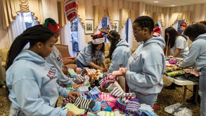 Poughkeepsie students spread holiday cheer at nursing home