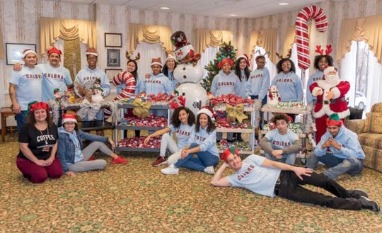 Poughkeepsie City School District students involved with theC.O.L.O.R.S. Foundation prepare holiday gifts for residents of The Pines at Poughkeepsie Center for Nursing and Rehabilitation on Dec. 22, 2018. ThroughHoliday Helping Hand,a collaboration between the Poughkeepsie Journal and United Way of the Dutchess-Orange Region, the program got $750 to help the community.
