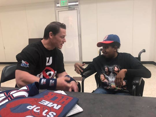 Geovan Green's mother Lashon Green-Glackin posted this photo of him meeting his WWE hero John Cena Friday, Dec.