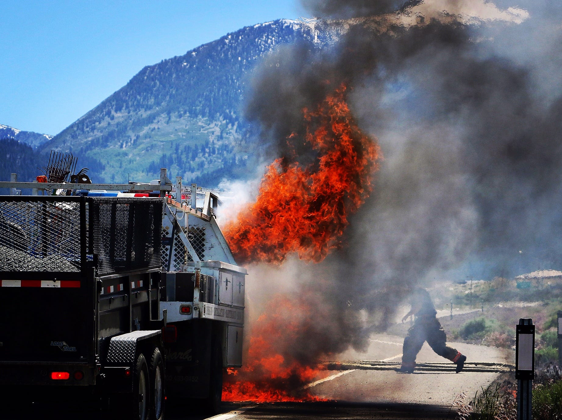 A vehicle catches on fire on the Mt. Rose Highway on June 13, 2018.