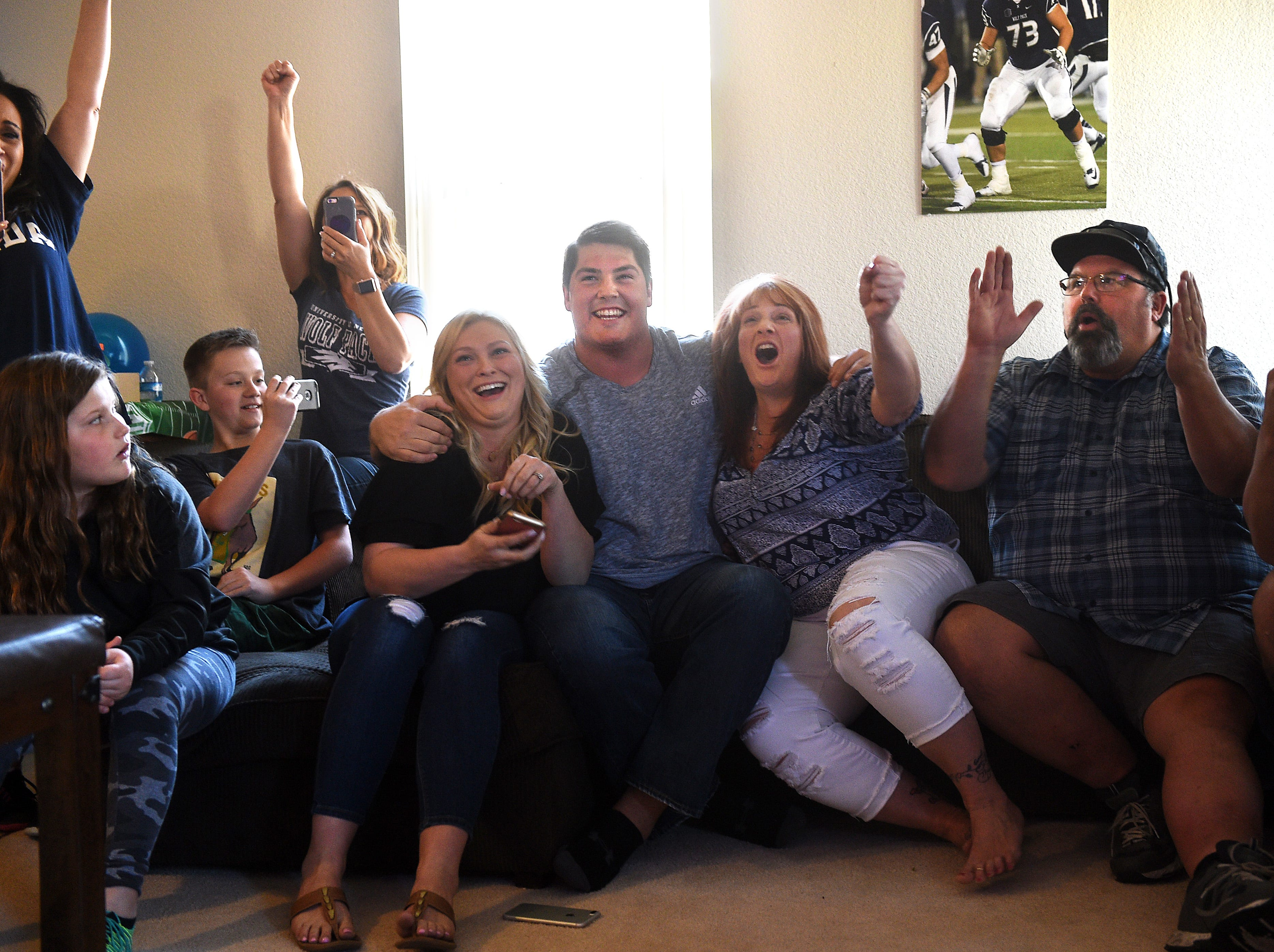 Austin Corbett, middle, and his family and friends react to the announcement that the Cleveland Browns selected him as the first pick of the second round of the NFL draft during a party at their home in Sparks on April 27, 2018. Surrounding Corbett are his wife Madison, left, and his mother Melissa and father Theron, on the right.